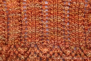Close up of stitch pattern used in shawl edging